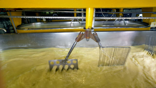 Double set of stirrers works on mixing milk. video