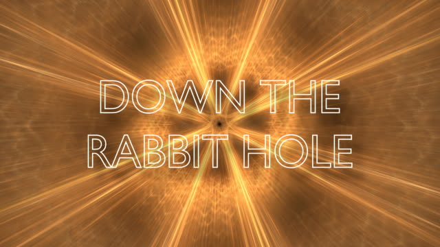 """Down the rabbit hole An animated image with the words """"Down the rabbit hole"""" moving in a spiral. Concept for the radicalizing effect of the algorithms. twisted stock videos & royalty-free footage"""