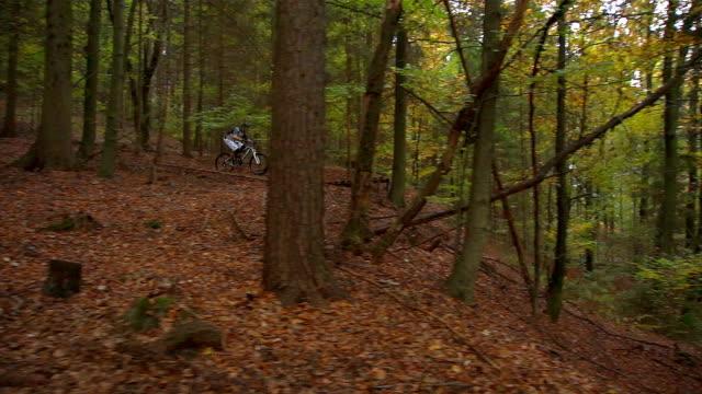 AERIAL: Downhill biker jumping video