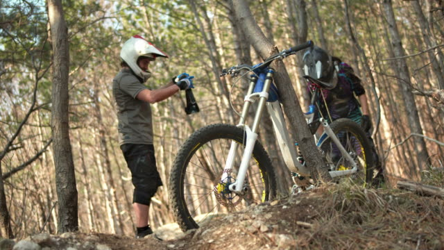 HD: Downhill Bikers Preparing For A Ride video