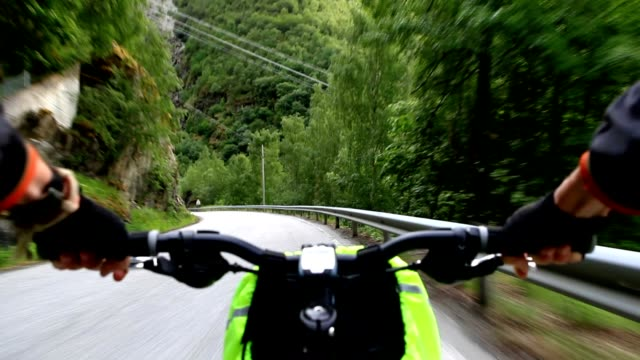 Downhill on bicycle. Riding a bicycle, view from saddle. handlebar stock videos & royalty-free footage
