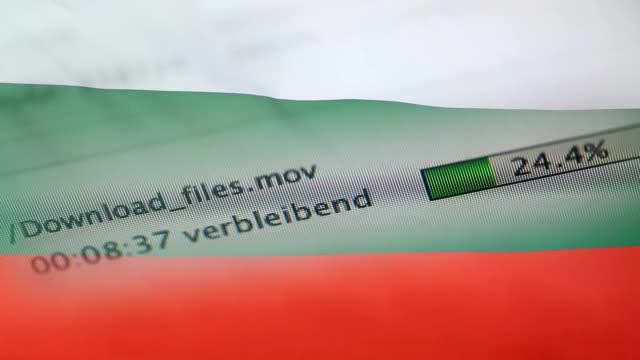 downloading files on a computer, bulgaria flag - kradzież tożsamości filmów i materiałów b-roll