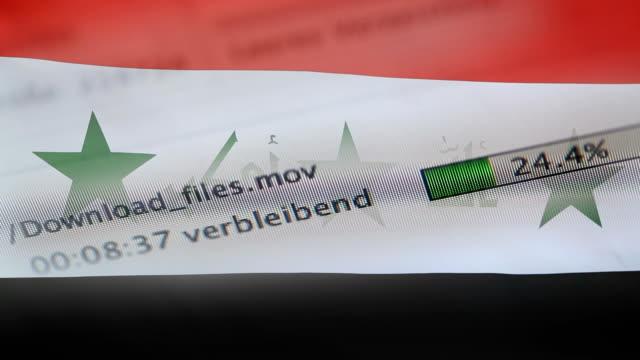 downloading files on a computer, iraq flag - kradzież tożsamości filmów i materiałów b-roll