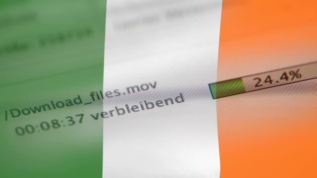 downloading files on a computer, ireland flag - kradzież tożsamości filmów i materiałów b-roll
