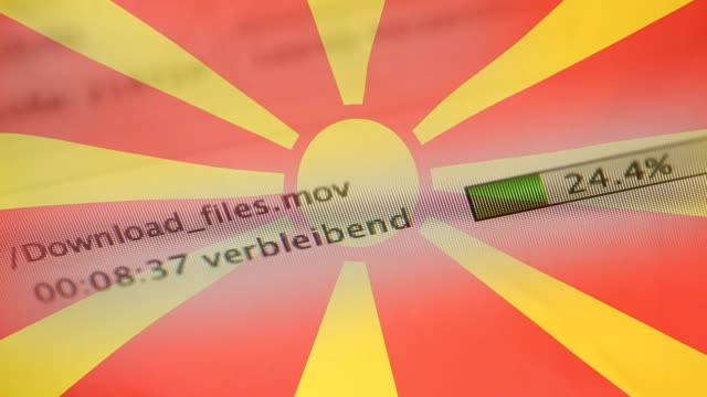 downloading files on a computer, macedonia flag - kradzież tożsamości filmów i materiałów b-roll