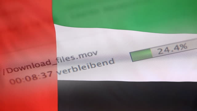 Downloading files on a computer, United Arab Emirates flag