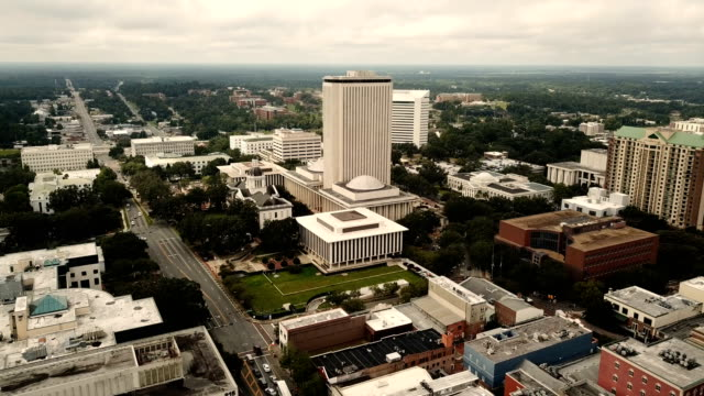 Downtown City Center Tallahassee Florida State Capitol Building Static Aerial view of the Florida state capitol building and the street traffic in downtown Tallahassee florida us state stock videos & royalty-free footage