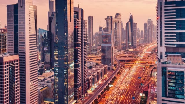 Downtown Dubai sunset time lapse - Skyscrapers reflecting pink light - future city video