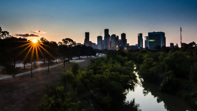 Downtown Houston Sunrise over bayou This is a sunrise looking at downtown Houston from buffalo bayou swamp stock videos & royalty-free footage