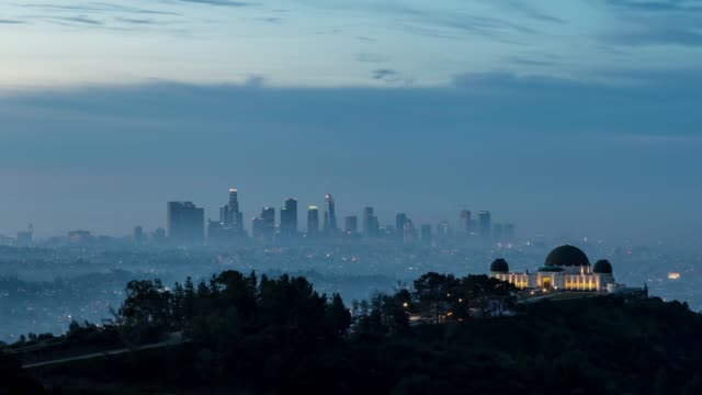 downtown los angeles and griffith observatory fog sunrise timelapse - smog video stock e b–roll