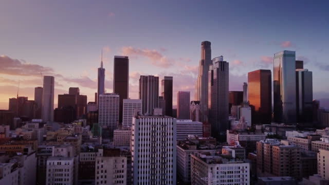 downtown los angeles at sunset - aerial shot - california video stock e b–roll