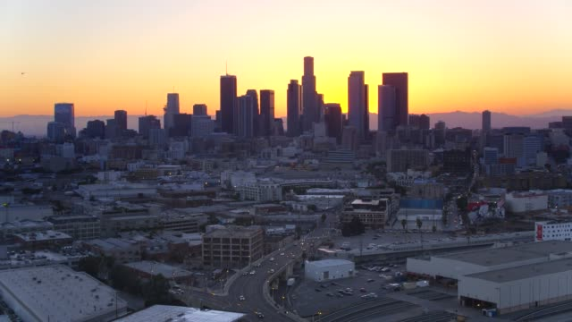 downtown los angeles at sunset by aerial drone downtown los angeles at sunset by aerial drone east stock videos & royalty-free footage