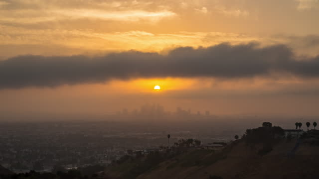 downtown los angeles cloudy sunrise timelapse - smog video stock e b–roll