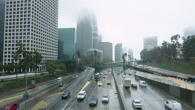 Downtown Los Angeles freeways and skyscrapers in the rain HD video
