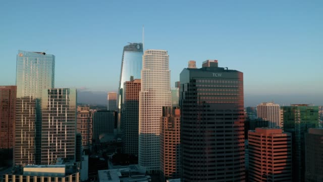 Downtown Los Angeles Skyline at Dusk- 4K Drone Footage Aerial drone shot of the skyscrapers, surrounding business in downtown Los Angeles at dusk. b roll stock videos & royalty-free footage
