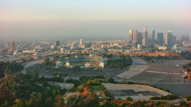 AERIAL Downtown Los Angeles with Dodger Stadium in the front