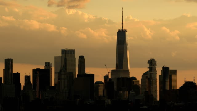 Downtown Manhattan Skyline Panorama Sunset clouds over the One World Trade Manhattan skyline in New York City. new york architecture stock videos & royalty-free footage