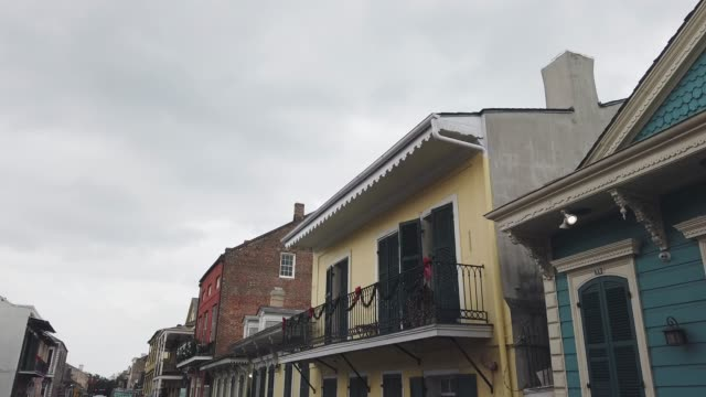 Downtown New Orleans Residential Buildings Decorated for Christmas in the French Quarter during the Day underneath an Overcast Sky