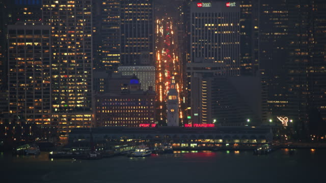 AERIAL Downtown San Francisco at night from the  San Francisco Ferry Building waterfront