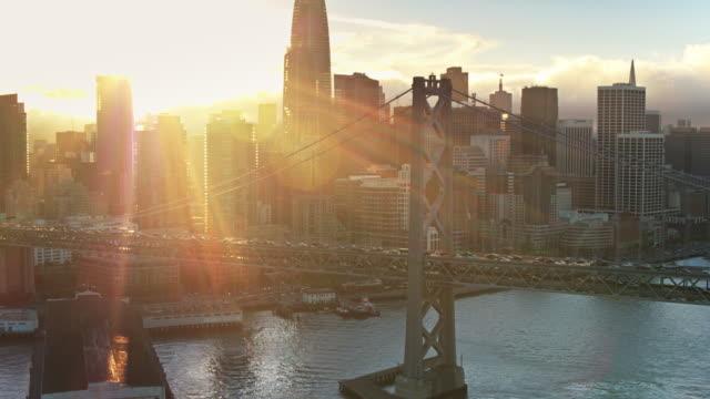 Downtown San Francisco, the Embarcadero and the Bay Bridge at Night - Drone Shot