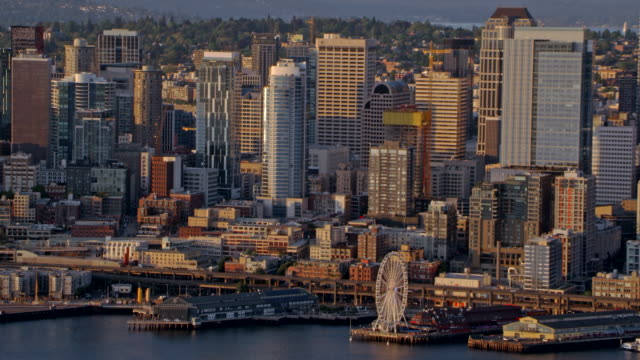 AERIAL Downtown Seattle at sunset Aerial shot of Downtown Seattle as the sun is setting. Shot in WA, USA. seattle stock videos & royalty-free footage