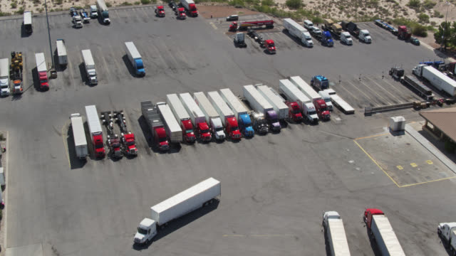 Downward Tilting Drone Shot of Truck Stop Aerial shot of semi-trucks refueling at a truck stop on the New Mexico/Texas border. semi truck stock videos & royalty-free footage