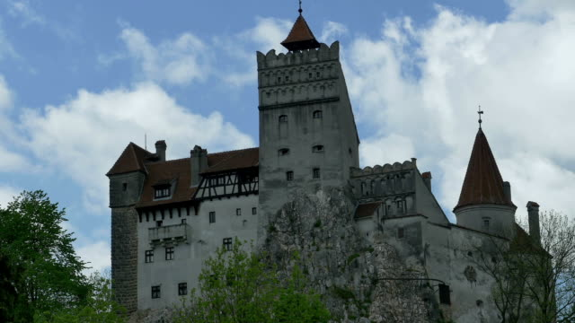 "Dracula Castle Da Timelapse in a spring day with the Bran Castle, Transylvania. Commonly known as ""Dracula's Castle"" linked to the Dracula legend, it is the home of the titular character in Bram Stoker's Dracula. count dracula stock videos & royalty-free footage"