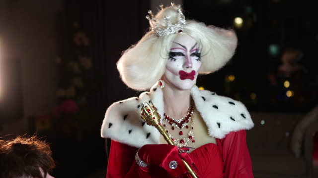 Drag queen wearing costume Transsexual man/drag queen wears  queen costume eyeshadow stock videos & royalty-free footage
