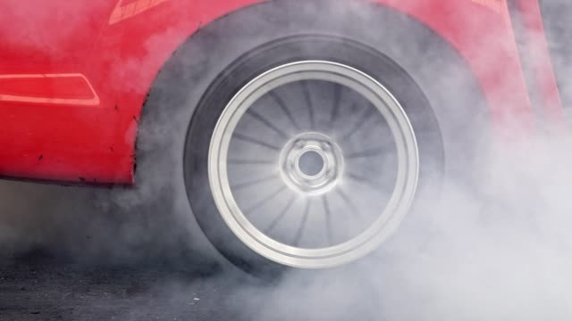 Drag racing car burn tire at start line Drag racing car burns rubber off its tires in preparation for the race tires stock videos & royalty-free footage