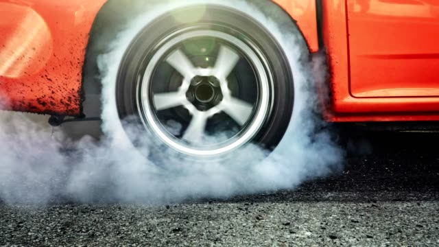 Drag racing car burn tires at start line video