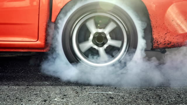 Drag racing car burns rubber off its tires in preparation for the race video