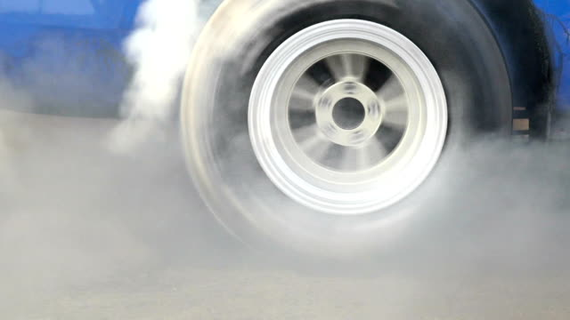 Drag racing car burns tires  for the race Drag racing car burns rubber off its tires in preparation for the race tires stock videos & royalty-free footage