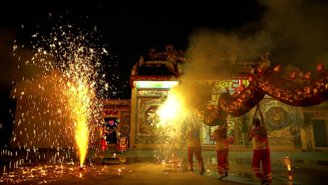 Dragon dance show with firework in the festival Chinese New Year in the night. Dragon dance show with firework in the festival Chinese New Year in the night. chinese new year stock videos & royalty-free footage
