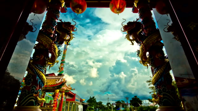 Dragon of Chinese shrine temple,Dolly shot Statue of a dragon on the front door of the Chinese shrine temple of the background sky is filled with clouds. chinese new year stock videos & royalty-free footage