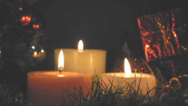 Dramatic or Vintage tone style burning candle and Christmas decoration video