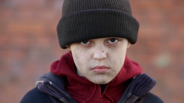 dramatic portrait of a little homeless boy - fuggitivo video stock e b–roll