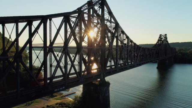 Dramatic Rising View of Pennsylvania Railroad Bridge at Sunset video