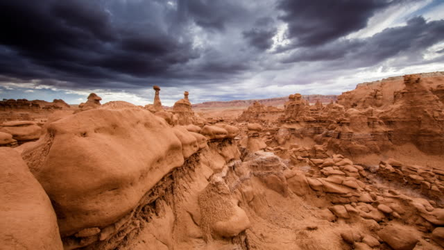 T/L 8K Dramatic sky over the Goblin Valley Motion control time lapse shot of a dramatic story cloudscape over the Goblin Valley. Goblin Valley State Park. Utah. Western USA. USA. Also available in 8K resolution. utah stock videos & royalty-free footage