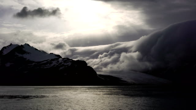 Dramatic snow covered mountainous landscape of Drygalski Fjord in southeastern South Georgia Island in the South Atlantic Ocean Dramatic snow covered mountainous landscape of Drygalski Fjord in southeastern South Georgia Island in the South Atlantic Ocean south georgia and the south sandwich islands stock videos & royalty-free footage
