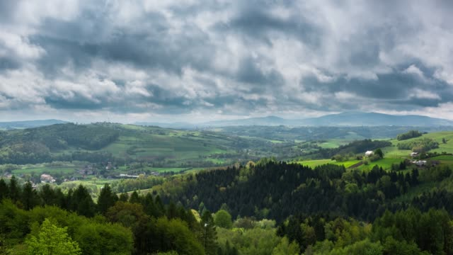 dramatic stormy clouds moving over beautiful polish countryside - paesaggio collinare video stock e b–roll
