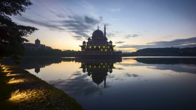 dramatic sunrise at putra mosque, putrajaya - ramadan stock videos and b-roll footage