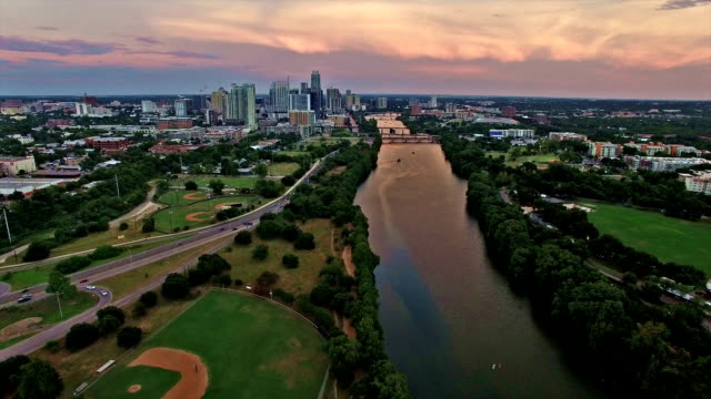Dramatic Sunset Brings Colors to Texas Hill Country Downtown Austin Texas City Skyline Over Colorado River over Baseball Field video