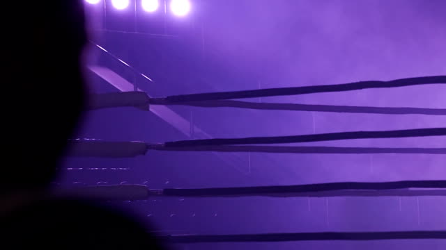 A dramatic view of the red corner of a regular boxing ring. Ropes in the corner of the ring. A dramatic view of the red corner of a regular boxing ring. Ropes in the corner of the ring. wrestling stock videos & royalty-free footage
