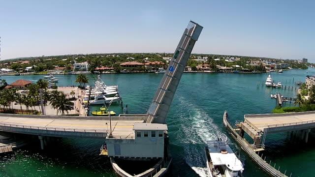 drawbridge aerial view - yat limanı stok videoları ve detay görüntü çekimi