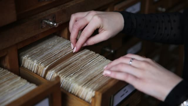 Drawer in library shelving for non-storage of catalog cards. video