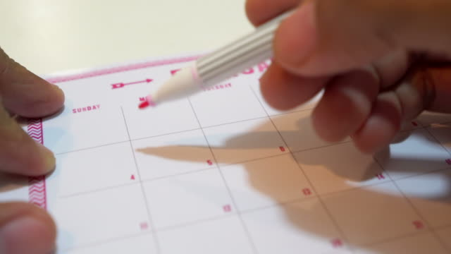 drawing a heart for valentines day on calendar - valentines day stock videos and b-roll footage