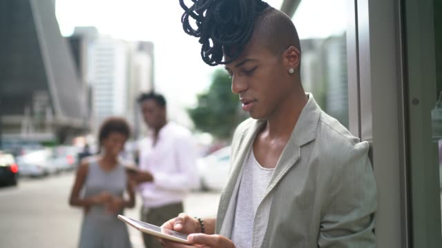 Dreadlocks businessman using tablet portrait on the city Dreadlocks businessman using tablet portrait on the city locs hairstyle stock videos & royalty-free footage