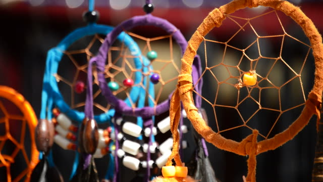 Dream catchers hanging in a display at outdoors video