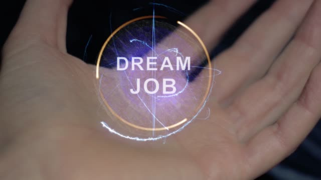 Dream job text hologram on a female hand Dream job text in a round conceptual hologram on a female hand. Close-up of a hand on a black background with future holographic technology promotion employment stock videos & royalty-free footage