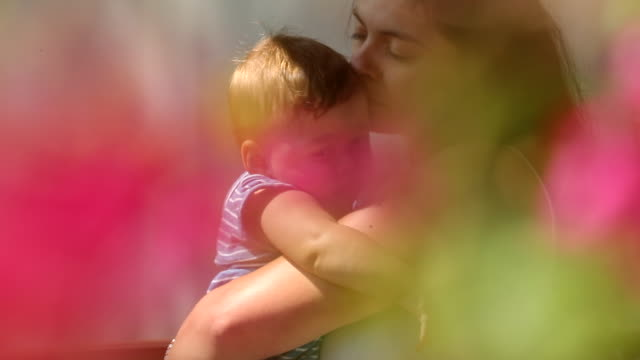 dreamlike feel of mother holding baby son - 0 11 mesi video stock e b–roll